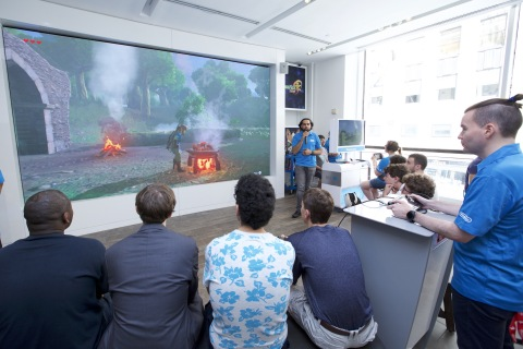 In this photo provided by Nintendo of America, dozens of fans at the Nintendo NY store in New York on June 14, 2016, watch as Nintendo game experts, Joel Taveras and Cory Holovach, guide them through an in-depth demonstration of The Legend of Zelda: Breath of the Wild, the newest entry in The Legend of Zelda series. From June 14 to June 19, 500 fans will be among the first people in the world to play The Legend of Zelda: Breath of the Wild for the Wii U console at the Nintendo NY store. During the same six days, Nintendo experts will also offer additional guided game-play demonstrations for fans to watch and enjoy.