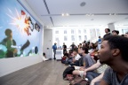In this photo provided by Nintendo of America, Nintendo fan, Joseph Osei, gathers at the Nintendo NY store in New York on June 14, 2016, to watch Nintendo Treehouse: Live, which was live-streamed from the E3 video game trade show in Los Angeles. During the live stream, Nintendo announced The Legend of Zelda: Breath of the Wild and highlighted the immense, living and breathing open-air adventure where challenge and surprise await at every turn.