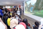 In this photo provided by Nintendo of America, Nintendo fans gather around the 15-foot gaming screen inside the Nintendo NY store on June 14, 2016 to watch the trailer for The Legend of Zelda: Breath of the Wild live-streamed from Nintendo's booth at this year's E3 video game trade show in Los Angeles. (Graphic: Business Wire)