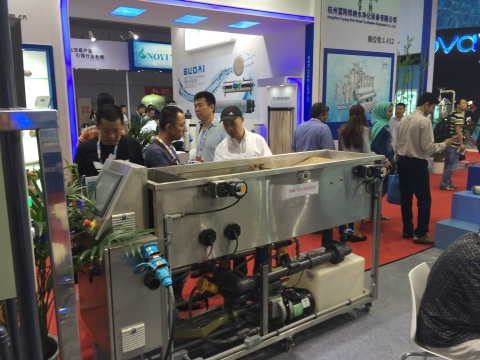 Visitors to Shanghai's Aquatech Innovation Pavilion observe a working demonstration of OriginClear's ...