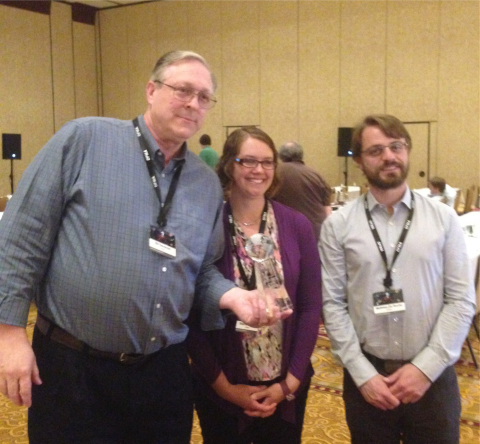 "(Left) Bill Devenish, Principal Engineer-Global DFx at the Kohler Company, with his ""Distinguished DFMA Supporter of the Year"" award. Devenish's colleague Stephanie Freier (middle) and Matthieu Da Rocha (right), attended the 2016 Boothroyd Dewhurst International Forum on Design for Manufacture and Assembly to learn more about implementing DFMA in an organization. (Photo: Business Wire)"