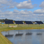 As part of its environmental effort, Toyota Alabama has a rainwater harvest pond. Solar panels power the pumps that send the water to the plant for processing. (Photo: Business Wire)