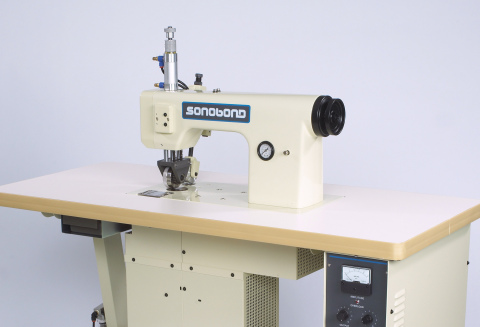 Sonobond's SeamMaster® High Profile Ultrasonic Sewing Machine creates a rugged, durable seal that's impervious to moisture without using needles, thread or glue. It operates up to four times faster than conventional sewing machines and can increase production output by over 25% compared to other assembly methods. (Photo: Business Wire)