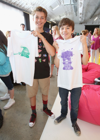 In this photo provided by Nintendo of America, kids show their custom Kirby t-shirts at the Kirby: Planet Robobot celebration at Smashbox Studios in Culver City, California, on June 22, 2016. In the new sci-fi adventure game, available now for the Nintendo 3DS family of systems, Kirby has the power to save his world from enemies with his mechanized Robobot Armor.