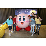 In this photo provided by Nintendo of America, kids meet Kirby at the Kirby: Planet Robobot celebration at Smashbox Studios in Culver City, California, on June 22, 2016. In the new sci-fi adventure game, available now for the Nintendo 3DS family of systems, Kirby has the power to save his world from enemies with his mechanized Robobot Armor.