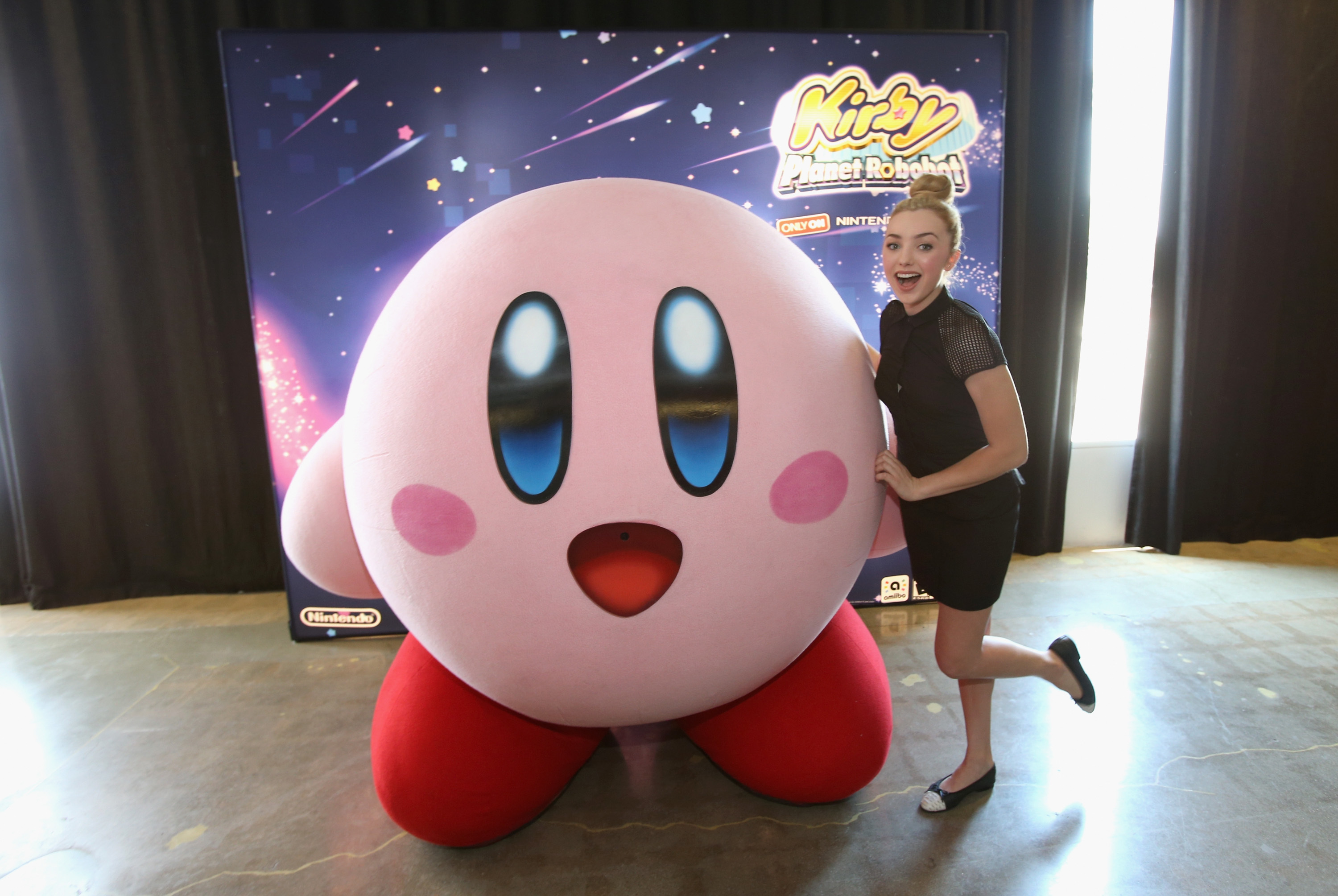 """In this photo provided by Nintendo of America, Peyton List from Disney's """"Bunk'd' who is starring in the upcoming feature """"The Thinning"""" attends the Kirby: Planet Robobot event celebrating the game's launch at Smashbox Studios in Culver City, California, on June 22, 2016. In this new action-packed adventure, Kirby gets new abilities and transformations, such as flamethrower arms and buzz-saw hands."""
