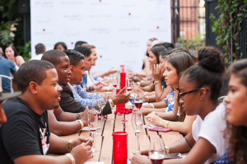 The attendees speed dating and sipping Banfi wines at the Houston Perfect Pairing event. (Photo: Business Wire)