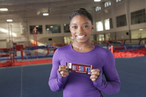Hershey's chocolate unveils partnership with U.S. Gymnast Simone Biles and advertising campaign that delivers messages on chocolate bars to Team USA athletes. (Photo: Business Wire)