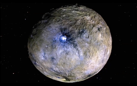 The dwarf planet Ceres is shown, including bright features revealed by Dawn at the Occator Crater that continue to spark scientific investigation. Image Credit: NASA/JPL-Caltech/UCAL/MPS/DLR/IDA