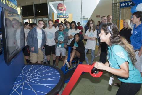 "A group of summer camp students race each other at the new ""Cycling to Wellness"" exhibit that opened today at the Connecticut Science Center. The exhibit is sponsored by UnitedHealthcare and challenges riders to a virtual cycling race while teaching users about the importance of exercise and a healthy diet (Photo: Alan Grant)."