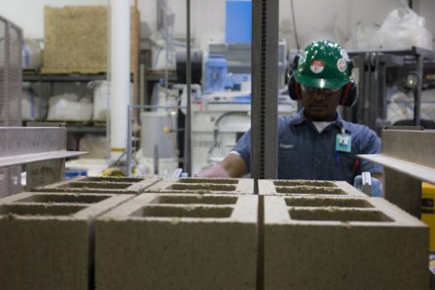 Solidia Concrete™ blocks being removed from press (Photo: Business Wire)
