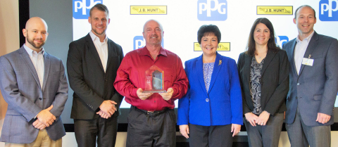 Karen Barkac (center right), PPG global director, transportation and logistics, and PPG transportation managers Mandi Penrod and Steve Minick (far right) present a 2015 Excellent Supplier Award to J.B. Hunt Transport representatives (from far left) Jerry Hoban, regional operations manager; Jamie Kleemook, transportation general manager; and Daniel Fike, Two Million Mile safe driver. (Photo: Business Wire)
