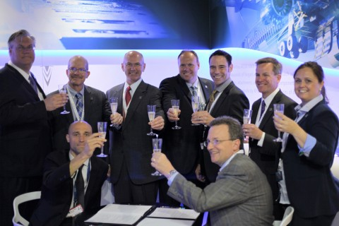 Mecachrome France CEO Arnaud de Ponnat and Norsk Titanium CEO Warren M. Boley, Jr. celebrate the signing of a Long Term Agreement for the supply of Rapid Plasma Deposition titanium parts to Mecachrome aerospace customers at the 2016 Farnborough International Airshow. (Photo: Business Wire)