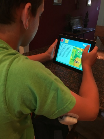 12 year old Podder™ Trent Wright exploring Omnipod's new Toby's T1D Tale educational app. (Photo: Business Wire)