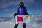 TMF Group brand ambassador Sir Ranulph Fiennes holds Marie Curie banner at the top of Mount Elbrus (Photo: Business Wire)