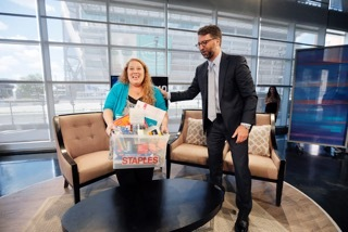 Bill Durling, VP, Global Communications for Staples, right, presents Jennifer Hatcher, a teacher at W. E. Greiner Exploratory Arts Academy in Dallas with a package of school supplies for her students, courtesy of Staples, during WFAA's Midday News broadcast, Tuesday, July 19, 2016, in Dallas, Texas. Durling announced that Staples is funding all teacher projects for Dallas, totaling $185,155, including Mrs. Hatcher's, currently active on DonorsChoose.org – a charity that has funded more than 700,000 classroom projects and impacted more than 18 million students across the U.S. Continuing its long-standing commitment to support education through its #StaplesforStudents program, Staples teamed up with global superstar Katy Perry earlier this year to announce a $1 million donation to DonorsChoose.org. (Brandon Wade/AP Images for Staples)