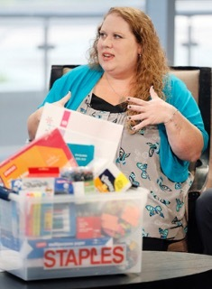 Jennifer Hatcher, a teacher at W. E. Greiner Exploratory Arts Academy in Dallas, accepts a package of school supplies for her students, courtesy of Staples, during WFAA's Midday News broadcast, Tuesday, July 19, 2016, in Dallas, Texas. Staples announced it's funding all teacher projects for Dallas, totaling $185,155, including Mrs. Hatcher's, currently active on DonorsChoose.org – a charity that has funded more than 700,000 classroom projects and impacted more than 18 million students across the U.S. Continuing its long-standing commitment to support education through its #StaplesforStudents program, Staples teamed up with global superstar Katy Perry earlier this year to announce a $1 million donation to DonorsChoose.org. (Brandon Wade/AP Images for Staples)