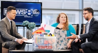 WFAA-TV's Midday News with host Ron Corning, left, looks on as Bill Durling, VP, Global Communications for Staples, right, presents Jennifer Hatcher, a teacher at W. E. Greiner Exploratory Arts Academy in Dallas, center, with a package of school supplies for her students, courtesy of Staples, during the stations broadcast, Tuesday, July 19, 2016, at WFAA's studios in Dallas, Texas. Durling announced that Staples is funding all teacher projects for Dallas, totaling $185,155, including Mrs. Hatcher's, currently active on DonorsChoose.org – a charity that has funded more than 700,000 classroom projects and impacted more than 18 million students across the U.S. Continuing its long-standing commitment to support education through its #StaplesforStudents program, Staples teamed up with global superstar Katy Perry earlier this year to announce a $1 million donation to DonorsChoose.org. (Brandon Wade/AP Images for Staples)