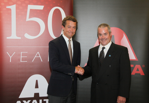 J. Geoff Piceu, CEO of United Paint (left), and David Grimes, Axalta Vice President, Global Automotive Plastic Components, announcing Axalta's acquisition of the automotive interior rigid thermoplastics coatings business of Michigan-based United Paint and Chemical Corporation. (Photo: Axalta)