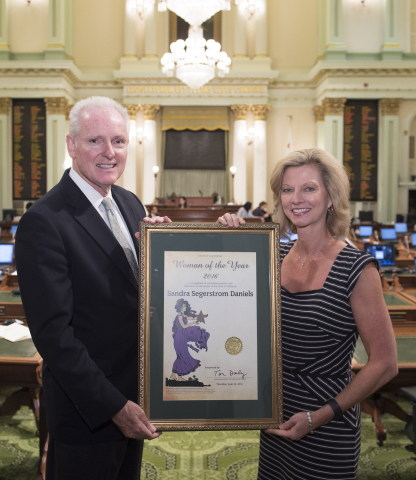 Assemblyman Tom Daly (D-Anaheim) presented Sandy Segerstrom Daniels, Co-Managing Partner at South Coast Plaza, with the 2016 Woman of the Year award. (Photo: Business Wire)