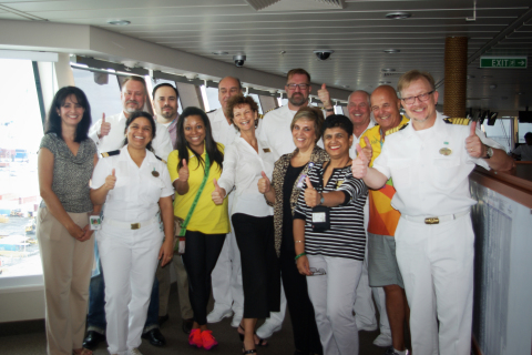 Pictured on the bridge of Norwegian Getaway with the Master of the vessel and his senior officers, is the core planning team from Landry & Kling Events At Sea, Norwegian Cruise Line, and the Rio 2016 Organizing Committee who gathered for a final review of plans for the 40-night charter before the ship's positioning voyage from Miami, non-stop to Rio. (Photo: Business Wire)