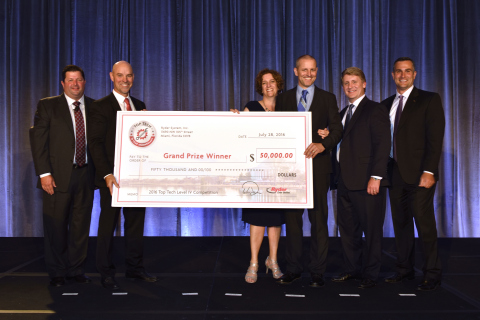 Top Tech winner Darek Mowinski shows off his $50,000 check alongside his wife Carlene and (from left ...