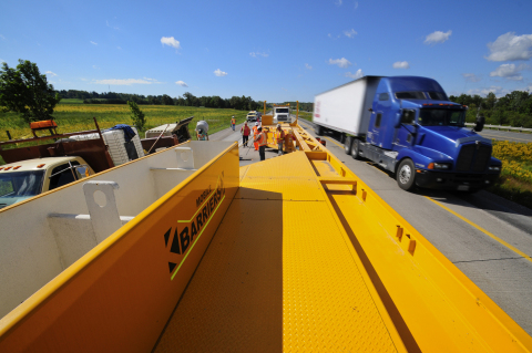 Mobile Barriers MBT-1, a highly mobile barrier, protects workers and increases efficiency in short term work zones. (Photo: Business Wire)
