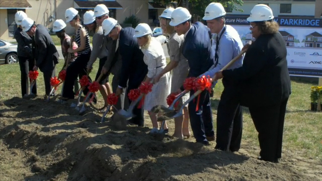 B-Roll of ceremonial shovel groundbreaking, demolition of old buildings and audience reaction and cheers to celebrate (Video: Lucas Christenson).