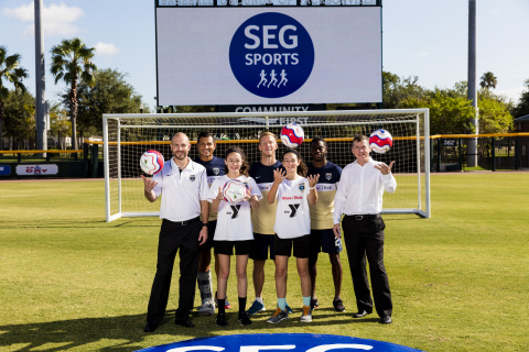 Ian McLeod, President and CEO of Southeastern Grocers, Mark Frisch, Owner and CEO of Jacksonville Armada FC, players from the Armada FC and the youth YMCA players, Avery Cannon and Macie Faucett, unite together at Community First to announce the launch of SEG Sports - the grocer's commitment to fuel, coach and inspire healthy lifestyles within the community. (Photo: Business Wire)