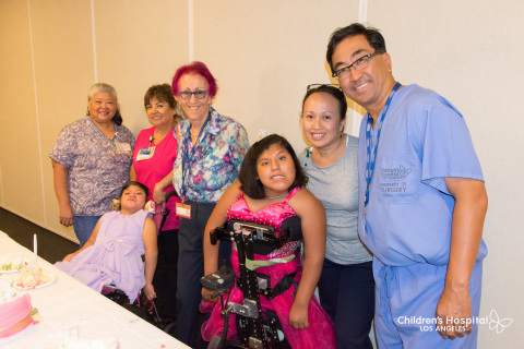 Josie Hull and Teresa Cajas are joined by doctors and staff from Children's Hospital Los Angeles. From left: Lourdes Argueta, Estela Barrios, Teresa Cajas, Dr. Wendy Mitchell, Josie Hull, Phan Leopando and Dr. Mark Urata. (Photo: Business Wire)