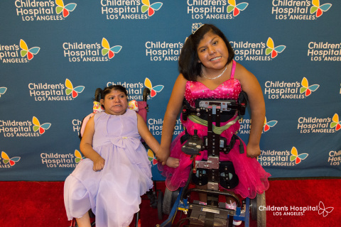 From Left: Teresa Cajas joins her sister Josie Hull on the red carpet at Children's Hospital Los Angeles. The formerly conjoined twins, 15, are celebrating their Quinceanera. (Photo: Business Wire)