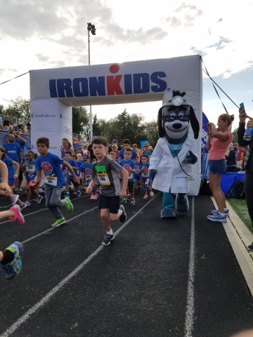 The UnitedHealthcare IRONKIDS Boulder Fun Run raced around Boulder High School this morning. UnitedHealthcare mascot Dr. Health E. Hound kicked off the fun run, and volunteers distributed medals to 370 kids as they crossed the finish line (Photo: Ken Kelley).