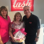 Amazing Lash Studio Franchisees Robin and Rudy Cortes with 50,000th member Ms. Lisa Catt-Orton (Photo: Business Wire)
