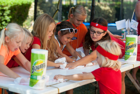 """Attendees of the """"Bounty 2016 Quicker Picker Upper Games"""" event raced against the clock to clean up messes and spills in record time with the help of Bounty on Saturday, Aug. 13, 2016, in Anaheim, Calif. (Photo by Carlos Delgado/AP Images for Bounty)"""