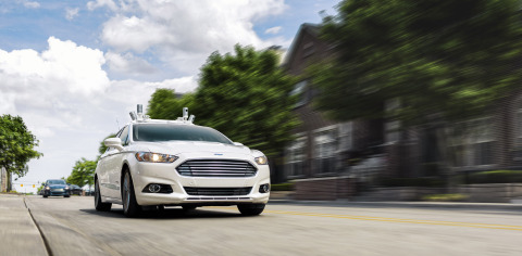 Ford's fully autonomous Fusion Hybrid research vehicle on streets of Dearborn, Michigan. Ford has been researching autonomous vehicles for more than a decade, and intends to have a high-volume, fully autonomous SAE level-4-capable vehicle in commercial operation for ride sharing services in 2021. Ford currently tests fully autonomous vehicles in Michigan, Arizona and California, and will triple its autonomous test fleet this year to have the largest test fleet of any automaker. (Photo: Business Wire)