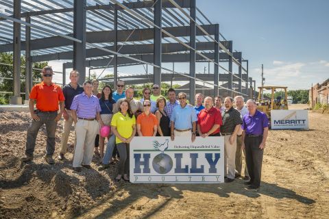 Merritt and Holly employees pose for a group photo in front of Holly's future poultry processing facility. (Photo: Business Wire)
