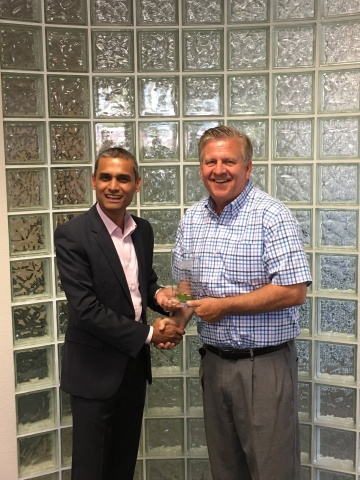 Quest President and CEO, Tim Burke (right) receives the VCSP Platinum plaque from Sanjay Robert (left), Veeam Territory Manager, Veeam Cloud & Service Providers - NW US & Canada West. (Photo: Business Wire)