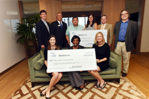 Project representatives attended a check presentation celebrating $20,000 in Partnership Grant Program funds from the Federal Home Loan Bank of Dallas and IBERIABANK to Puentes New Orleans, who received $12,000, and the Urban Conservancy, who received $8,000. (Photo: Business Wire)