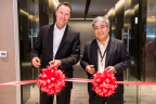 ServiceSource Chief Operating Officer Brian Delaney and Vice President of Managed Services for ServiceSource's APJ Region cut the ceremonial ribbon to celebrate the grand opening of the company's new Singapore office. (Photo: Business Wire)