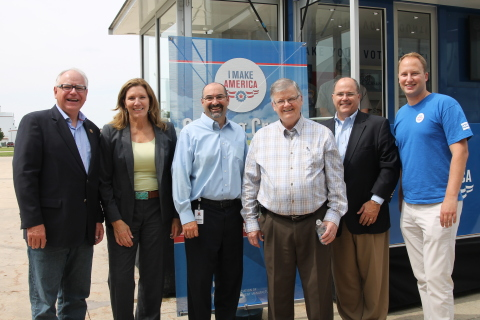 """After welcoming approximately 150 AGCO Jackson employees at the event, they paused for a group photo in front of the AEM """"I Make America"""" event trailer. From left to right, Representative Tim Walz, Senator Julie Rosen, Eric Fisher (Director of Operations, AGCO Jackson), Representative Bob Gunther, Bill Hurley (VP of Sales, AGCO North America), and Alexander Russ (Director of International & Regulatory Affairs, AEM). (Photo: Business Wire)"""