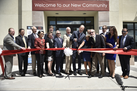 U.S. Representative Michelle Lujan Grisham (NM-District 1) and Albuquerque Mayor Richard Berry are joined August 29, 2016, by local dignitaries and representatives of Wells Fargo, the Federal Home Loan Bank of Dallas, and YES Housing for the grand opening of the Imperial Building in downtown Albuquerque, New Mexico. (Photo: Business Wire)