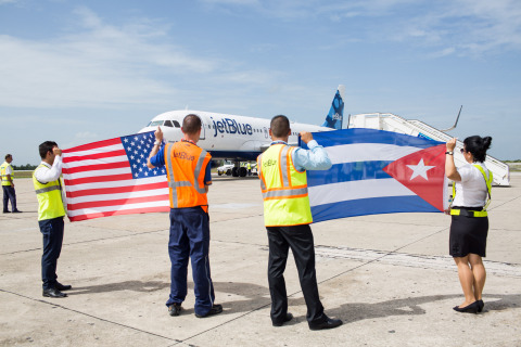 Crewmembers at the Santa Clara Abel Santamaría International Airport in Cuba welcome JetBlue flight 387, the first commercial flight to Cuba from U.S. in more than 50 years. (Photo: Business Wire)