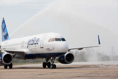 JetBlue flight 387, the first commercial flight to Cuba from U.S. in more than 50 years, arrives in Santa Clara, Cuba, to a water cannon salute. (Photo: Business Wire)