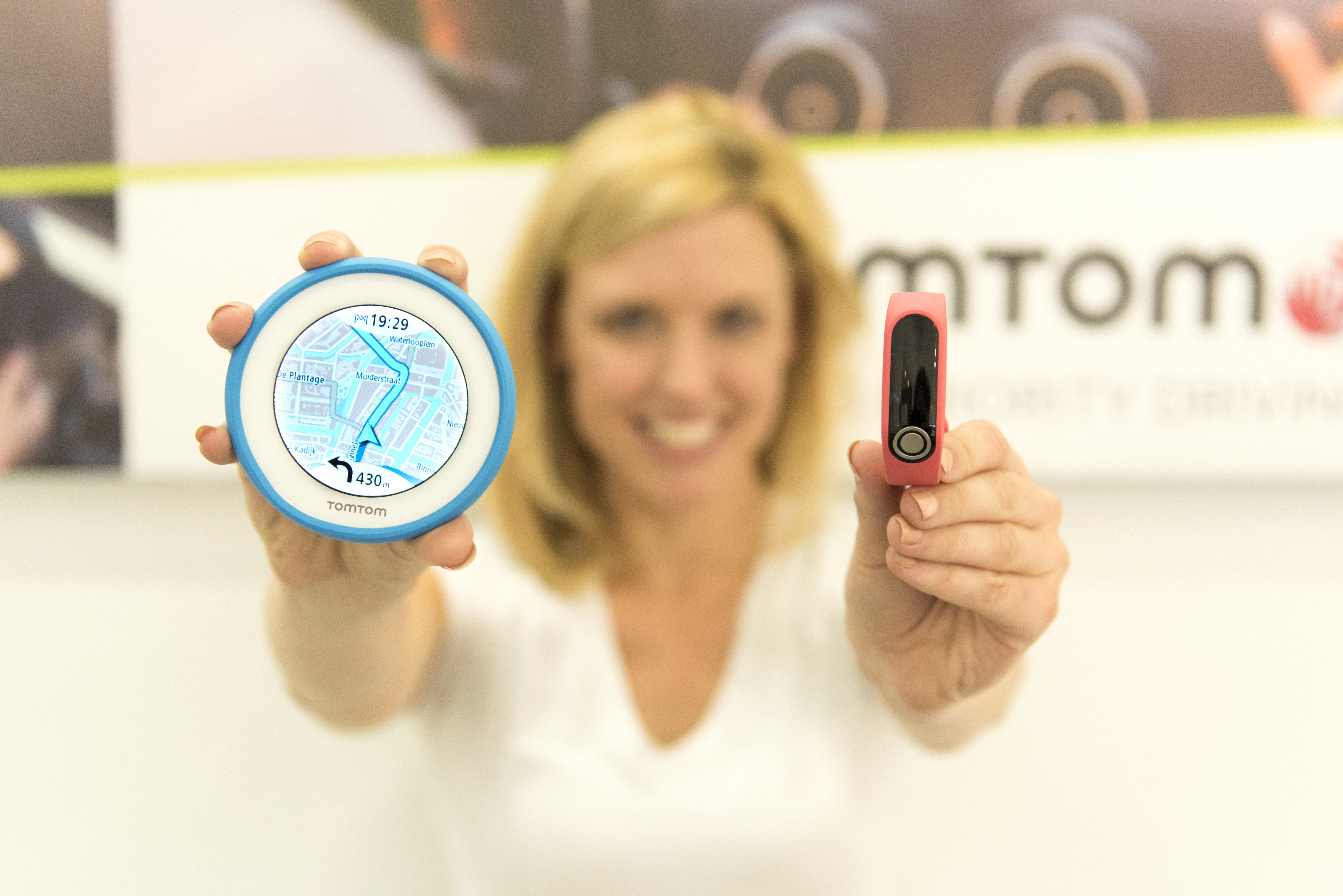 TomTom introduces two world firsts today. TomTom VIO is the world's first navigation device for scooters, and TomTom TOUCH the first fitness tracker with body composition analysis. (Photo: Business Wire)