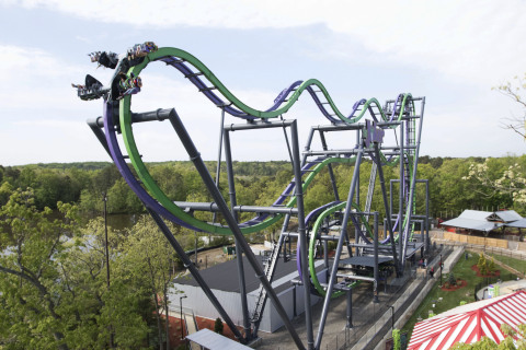 "The Joker: 4D Free Fly Coaster will open in 2017 at Six Flags New England. After being lifted straight up a 120-foot hill, this 4D Wing Coaster challenges riders to ""face their fears"" as they flip head-over-heels from four to eight times along the weightless, tumbling journey. Along the way on this 4th dimension free-fly coaster, thrill seekers experience exhilarating coaster hills and unexpected drops along with an interactive ride experience, making it a different sensation each time guests ride. The Joker: 4D Free Fly Coaster allows adrenaline seekers to soar outside the confines of the track for an all-new coaster riding experience. (Photo: Business Wire)"