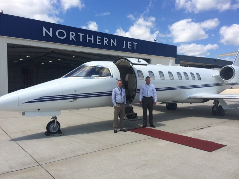 Pilots Steve Edmondson, left, and Andy Heemstra pose in front of the Bombardier Learjet 45XR they flew to establish the world record for a flight between Grand Rapids and Naples, Florida. (Photo: Business Wire)
