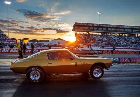 """""""Papa John"""" Schnatter raced his prized gold '71 Camaro against Don Schumacher Racing's Leah Pritchett, driver of the Papa John's dragster, on Friday, Sept. 2, 2016 at NHRA U.S. Nationals for the winner's charity of choice. Papa John's and DSR put up $10,000 each for Riley's Hospital for Children, adding $20,000 to funds already raised through pizza sales earlier in the day. (Photo: Business Wire)"""