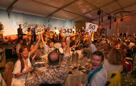 Bidders support the Sonoma Harvest Wine Auction highest grossing lot of the day, the Fund the Future Lot which supports the Sonoma County wine industry's childhood literacy initiative. Photo by George Rose
