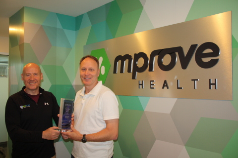Ostendio CEO, Grant Elliott, and Jeff Lee, CEO at mProve Health (Photo: Business Wire)