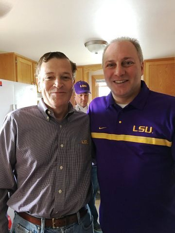 Majority Whip Steve Scalise and Abode Properties CEO Daniel Moos cheer on their LSU Tigers. (Photo: Business Wire)